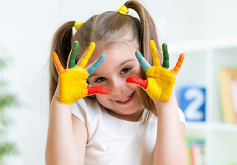 child girl with painted fingers