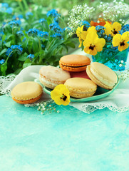 Macaroons with spring flowers