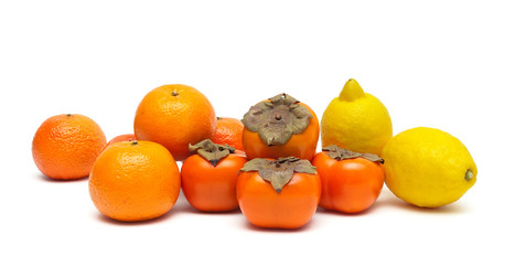 lemons, tangerines and persimmons isolated on white background c