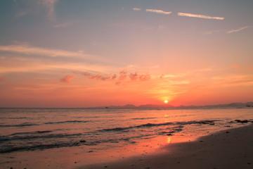Sun setting to the sea