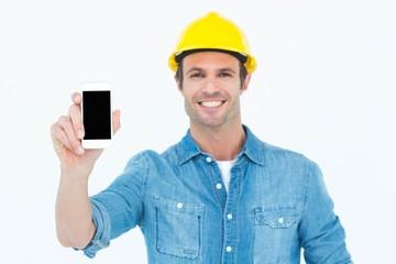 Happy carpenter showing smart phone