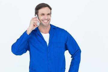 Mechanic using mobile phone over white background