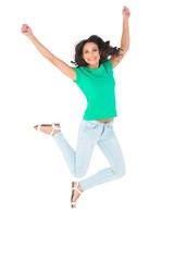 Pretty brunette jumping and smiling