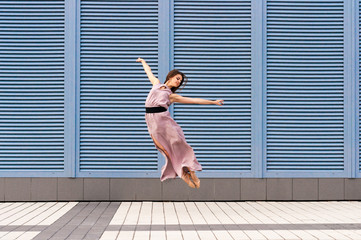 Ballerina dancing in casual clothes jumping on tiptoes