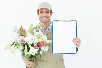 Happy delivery man holding bouquet and clipboard
