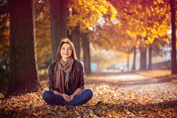 girl sitting park autumn