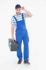 Confident male handyman carrying toolbox