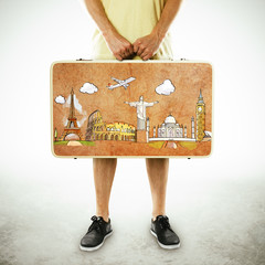 men holding leather suitcase