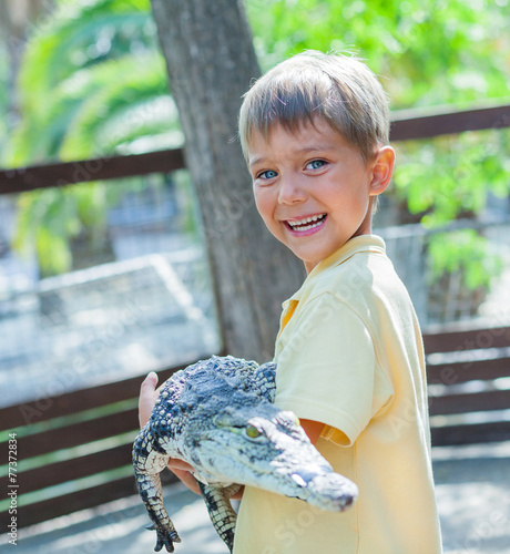Fotobehang Krokodil Boy with crocodile.