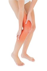 Closeup low section of a fit woman with leg pain