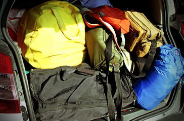suitcases and travel bags in the trunk