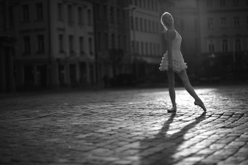 Ballerina standing in the city square, monochrome