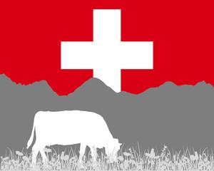 Kuh Alm und Schweizerfahne