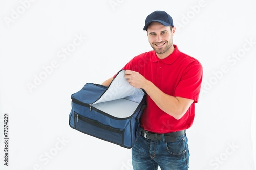 Fototapeta Pizza delivery man opening bag