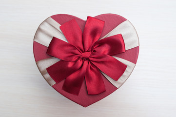 holiday box in the shape of a heart with a bow, Valentine's Day