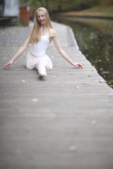 Beautiful girl training split outdoors