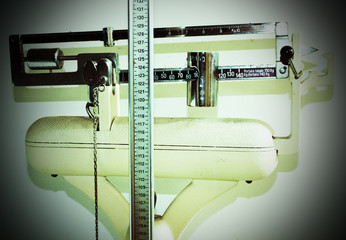 old bathroom scale with measuring rod