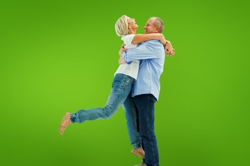 Composite image of mature couple hugging and having fun