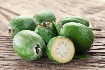 Feijoa fruits on old wooden table.