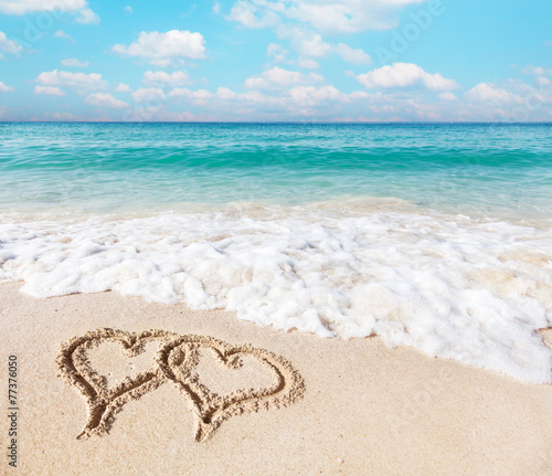 canvas print picture Hearts drawn on the beach sand.