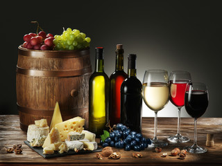 Still-life with wine, cheeses and fruits.