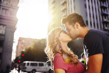 romantic couple kissing in downtown los angeles