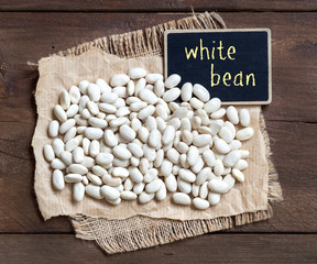 White beans with a small chalkboard