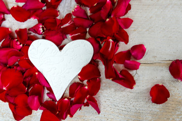 Love: white reart and red rose petals :)