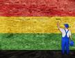 Painter paints flag of Reggae music