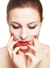 Beautiful woman with make up and red nails