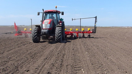 Tractor planting seeds, two video clips