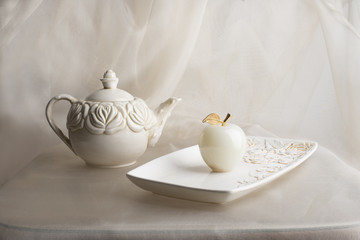 Teapot, tray and marble apple