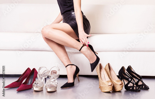 Woman trying on shoes. - 77378051