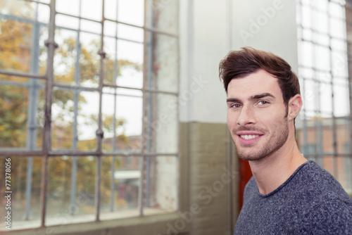 canvas print picture mann steht vor hohen fenstern