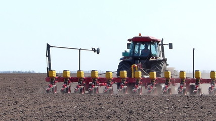 Tractor sowing and cultivating field