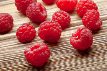 raspberries close up on wooden worktop