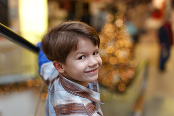 Little boy on escalator