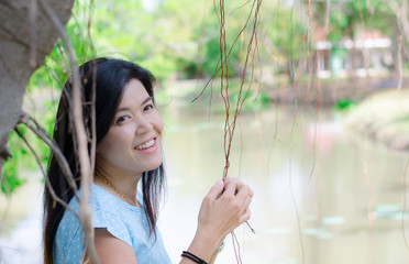 Asian woman portriat smiling in the park