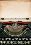 Antique typewriter with aged textured paper sheet