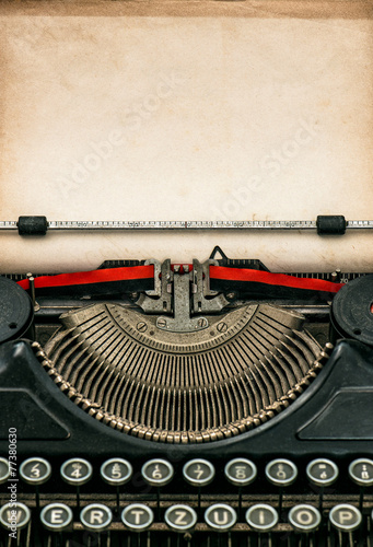 Antique typewriter with aged textured paper sheet - 77380630