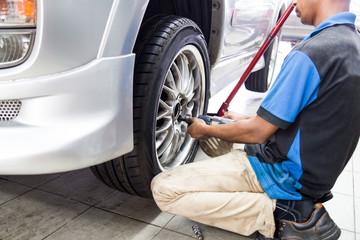 Mechanics fastening screw on the rim of the wheel