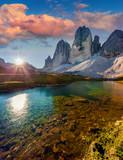 Colorful summer sunrise on the lake Rienza