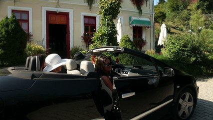 Shot of a four women getting out of the car and entering in a chocolate shop