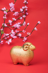 Ceramic goat souvenir on red paper,Chinese calligraphy. word for