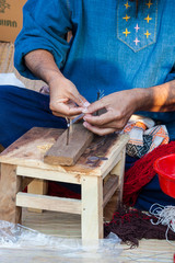 man demonatrate to make a handcraft