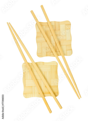 Chopsticks on the yellow bamboo stand. - 77386033