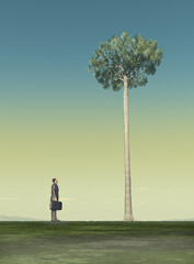 Hombre de negocios frente a un árbol muy alto