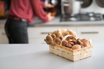 Closeup on basket with mushrooms on table