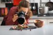 Leinwandbild Motiv Young woman photographing food