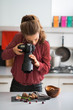 Young woman photographing food - 77387418